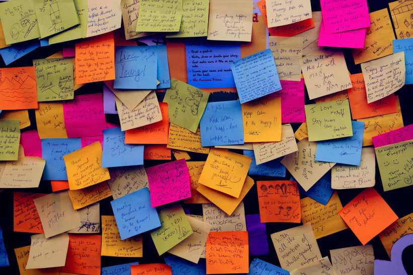 post it notes on wall of subway